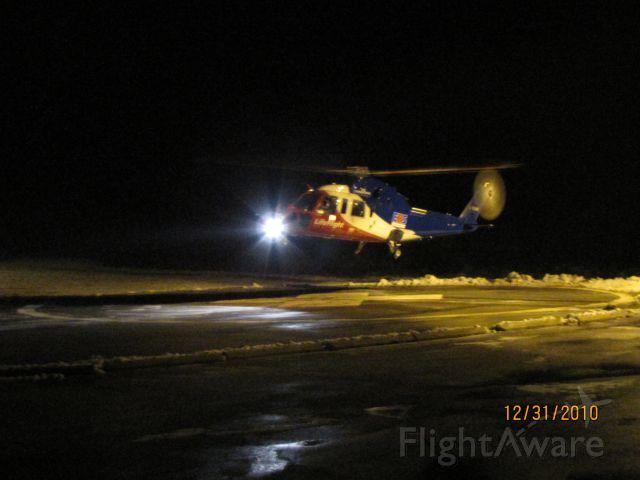 Sikorsky S-76 (C-GIMN) - Life Flight lifting the pad at South Shore Regional Hospital Bridgewater.. Dec 31,2010