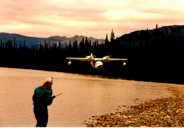 Grumman G-44 Widgeon (N575L) - North Fork of the Koyukuk River, Alaska Dropping food out the window to floaters