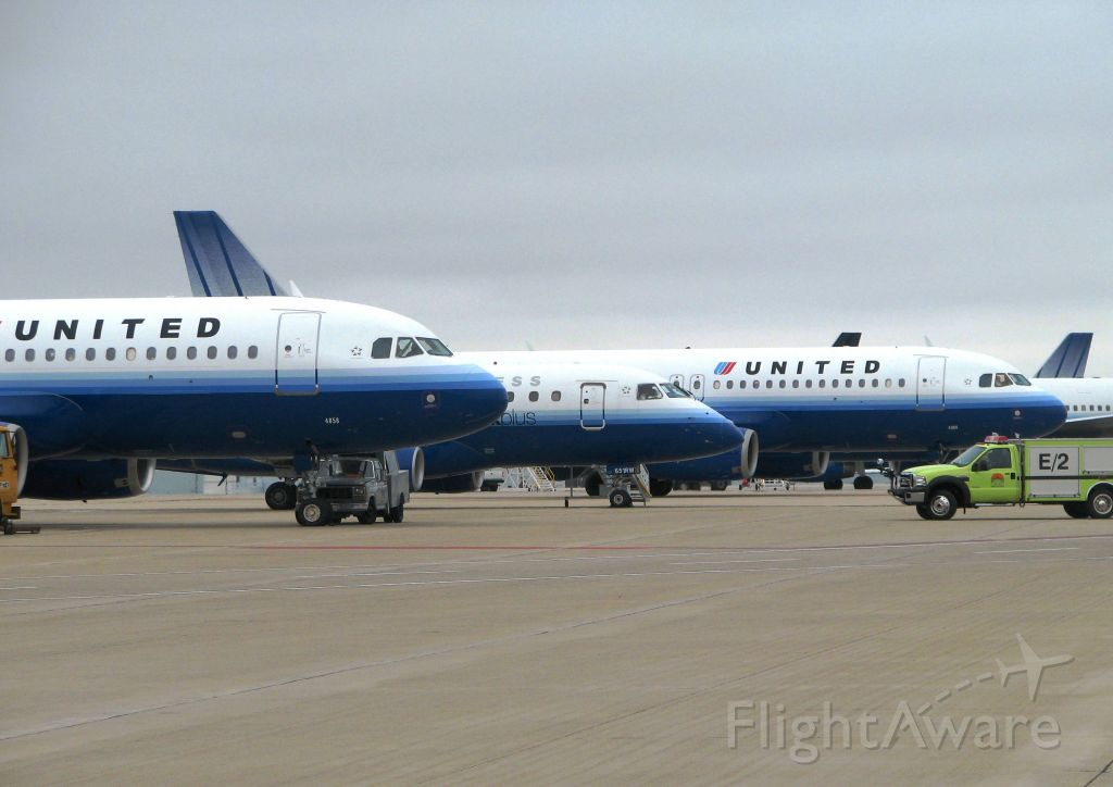 Airbus A320 (N485UA) - Three of 12 diverted flights from ORD, wait for clearance on the UPS ramp at KRFD