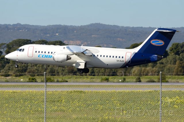 Avro RJ-100 Avroliner (VH-NJH) - About to put down on runway 05. Tuesday 22nd July 2014.