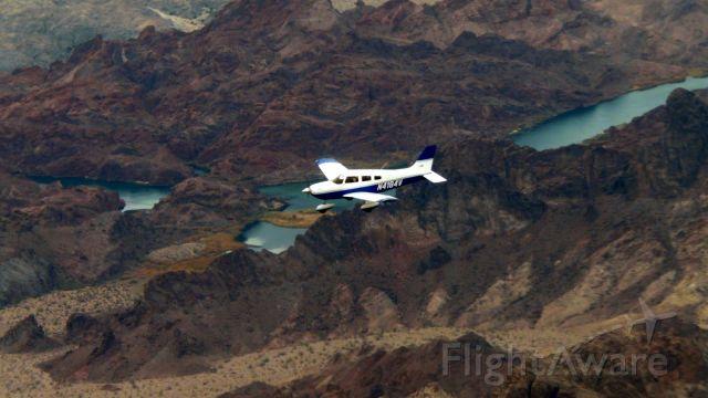 Piper Cherokee (N4184V) - Over the Colorado river on Arizona-California border.