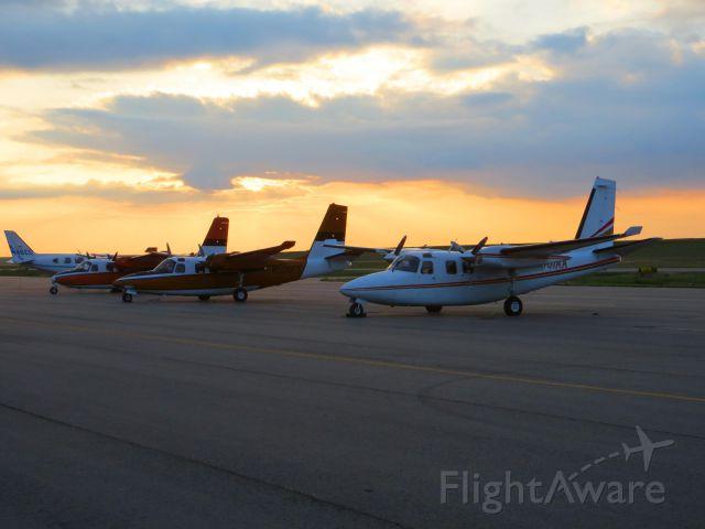 Aero Commander 500 (N101AA) - Three fire spotting/command birds waiting for their season to start.