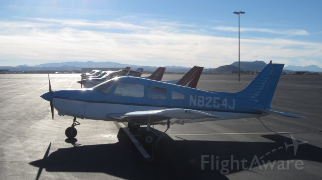 Piper Cherokee (N8254J) - This blue Piper Cherokee parked at Tucson International Airport just next to the tower