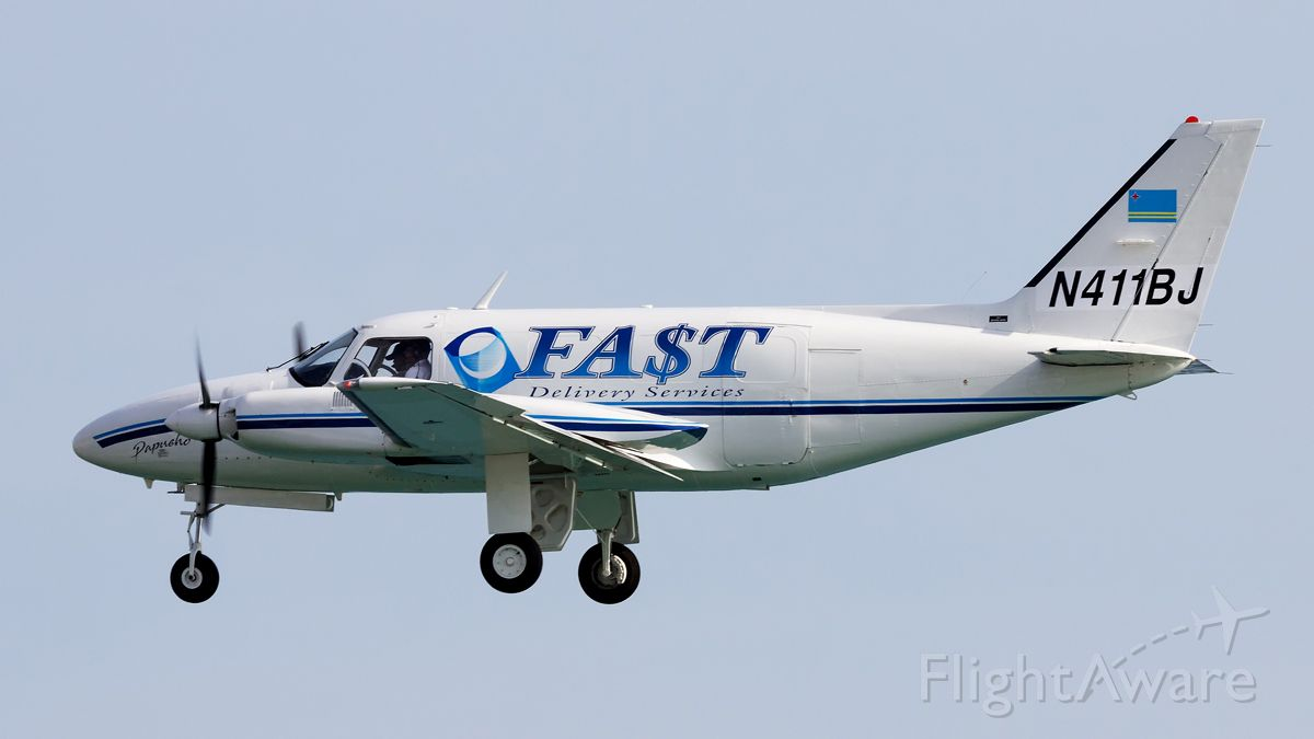 Piper Navajo (N411BJ) - New cargo airline on the island.
