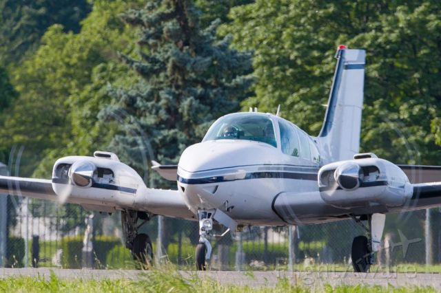 Beechcraft 55 Baron (N4LP) - Kelsey and I pose our Baron.