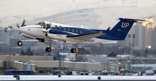 Beechcraft Super King Air 350 (N838UP) - Off and on the climb from 16L.