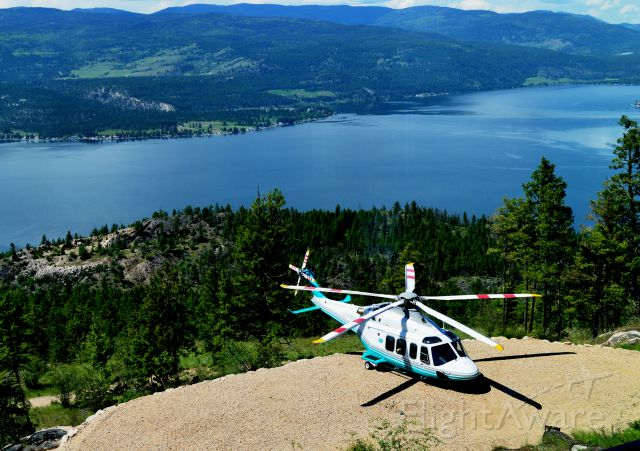BELL-AGUSTA AB-139 (C-FBKA) - from my resort room overlooking pad and Okanagan Lake, BC. titled  Land on the spot or else.