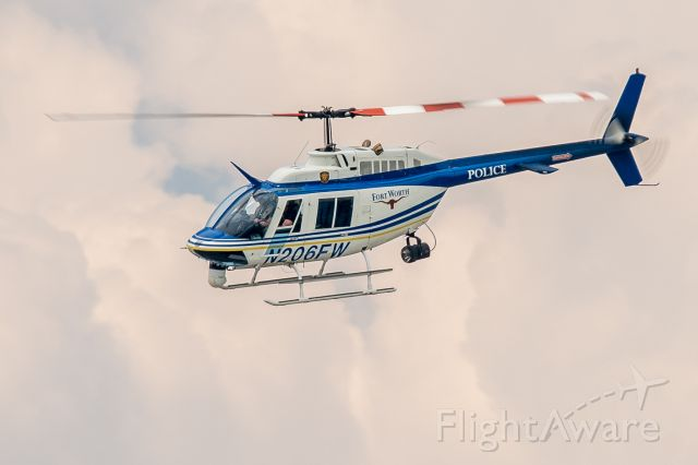 N206FW — - Police assisting the search of a suspect last seen on foot on the west side of Fort Worth, TX.