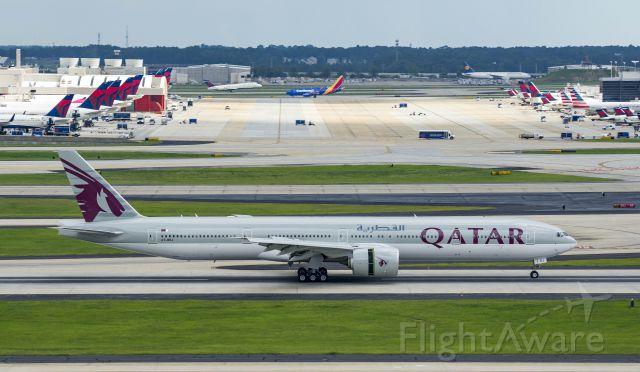 BOEING 777-300 (A7-BEJ) - Arriving 26Rbr /6/17/17