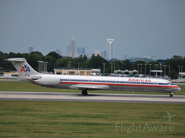 McDonnell Douglas MD-83 (N9622A) - Rolling 18C with downtown Charlotte in the background - 7/19/12