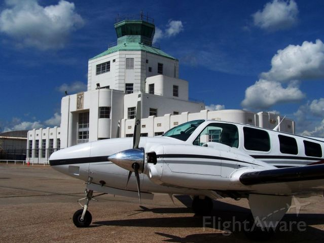 Beechcraft Baron (58) (N501CE) - Parked in front of the 1940 Air Terminal Museum.