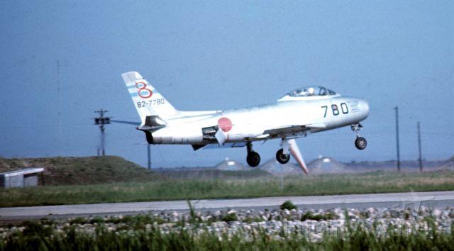 82-7780 — - A Japanese Self-Defense Force FJ-4 Fury jet landing at MCAS Iwakuni, Japan, 1967. Note deployed speed brakes.  Artifact under mid-fuselage is local windsock.
