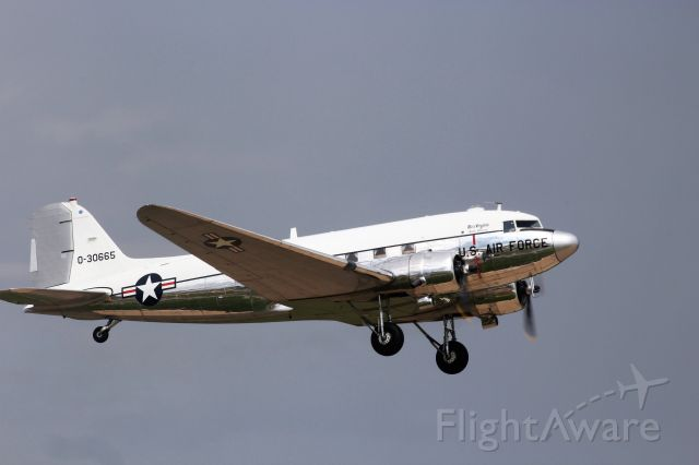 Douglas DC-3 (N47E) - Take-Off during Friday Warbird Show during Dark Skies 2018 Oshkosh.  Built by Douglas in 1943 & owned by Dynamic Aviation.  Spent many of its days spraying for gypsy moths & other insects.