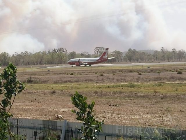 BOEING 737-300 (BMBR137) - Backtracking runway 33 Rockhampton at the peak of the bushfire emergency at Gracemere November 30, 2018