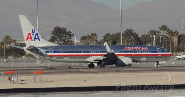 Boeing 737-800 (N950AN) - Taken on December 31, 2013. This Boeing 737-800 was taxing to runway 1 for takeoff at Las Vegas McCarran Airport.