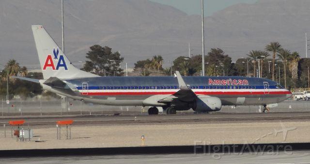 Boeing 737-800 (N950AN) - Taken on December 31, 2013. This Boeing 737-800 was taxing to runway 1 for takeoff at Las Vegas McCarran Airport.