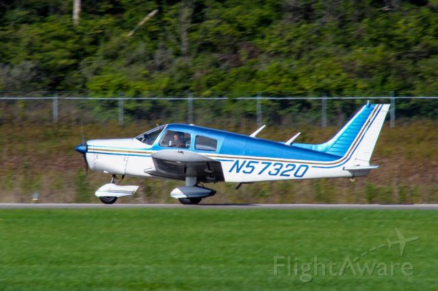 Piper Cherokee (N57320) - A Piper Cherokee lands at Butler County Regional Airport.