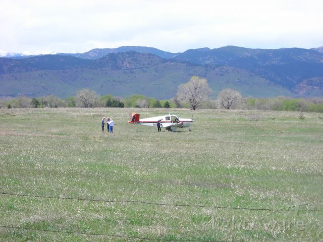 Beechcraft 35 Bonanza (N8SM) - damaged plane in field ... you can see that the right wing is damaged from going through the fence (possibly) to come to rest in this field.