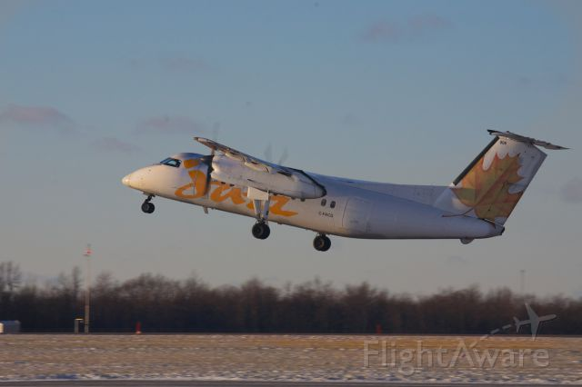 de Havilland Dash 8-100 (C-FACD) - Dash 8 lifts off Runway 25, headed for Toronto and the low Sun of a Winter afternoon..
