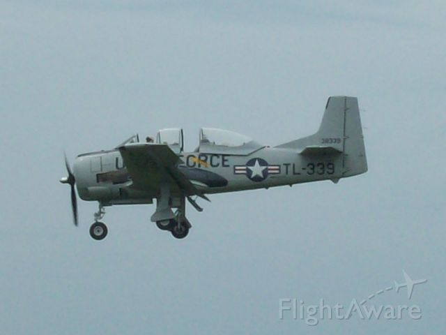 — — - After practicing his airshow routine this T-28 is seen on short final RWY18 at SPI