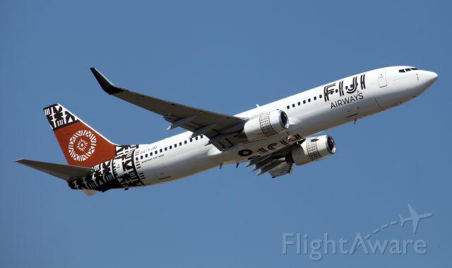 Boeing 737-800 (DQ-FJM) - Departing 34L