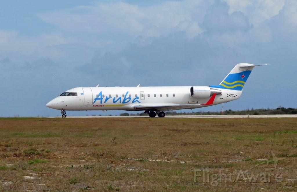 Canadair Regional Jet CRJ-200 (C-FXLH) - ARU508 TNCB-TNCC-TNCA CRJ2 C-FXLH lining up on RWY 10 at TNCB. Aruba Airlines is TNCB