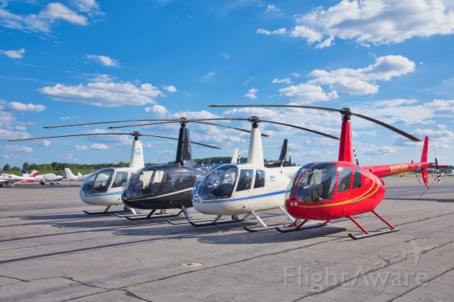 Robinson R-44 — - Flock of Robinson Helicopters.