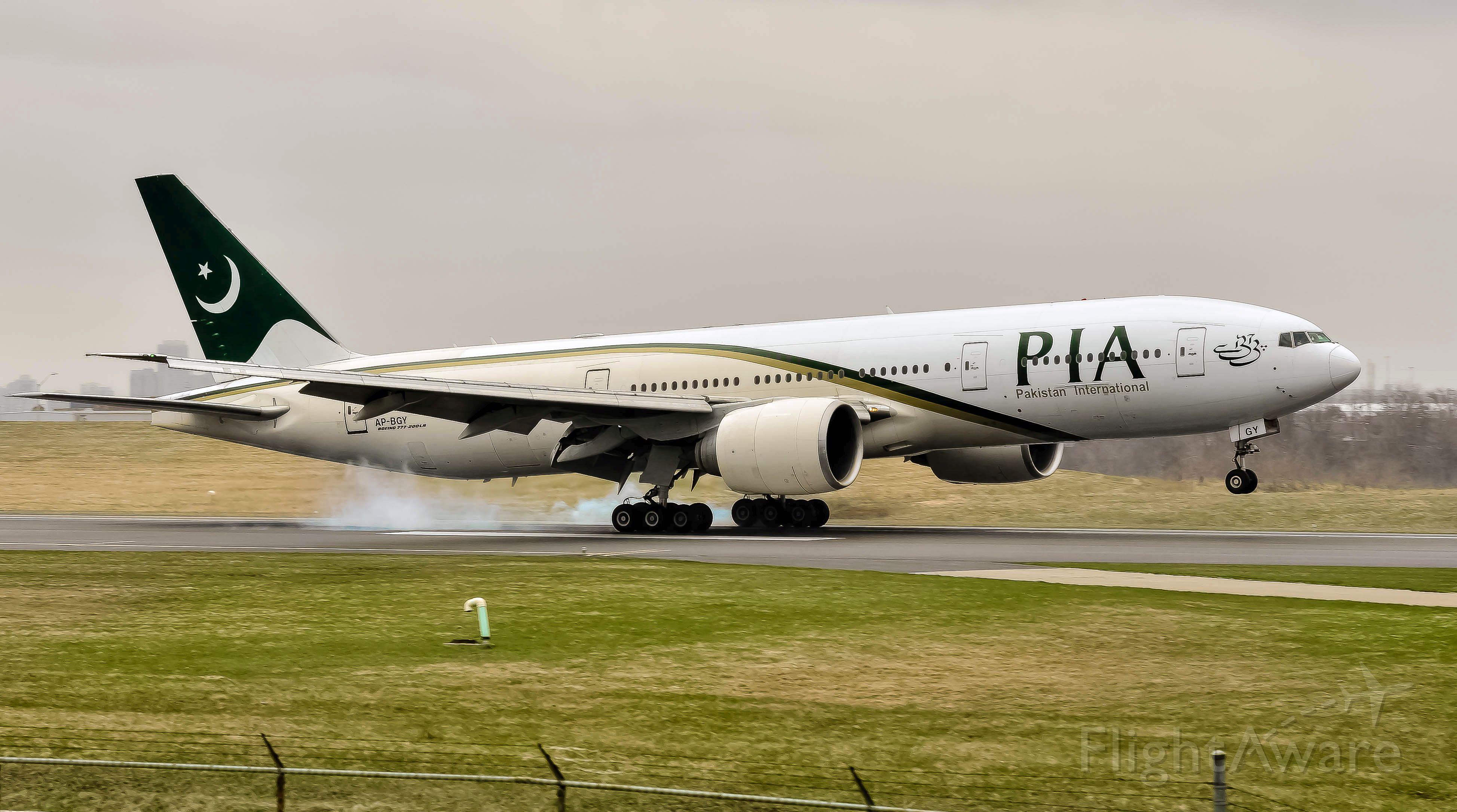 Boeing 777-200 (AP-BGY) - PIA 772L landing in light rain AP-BGY