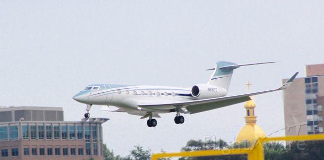 "Gulfstream Aerospace Gulfstream G650 (N251TD) - ""Angel wings"". Taken evening  of 09/08, EDG51 arriving from MCI"