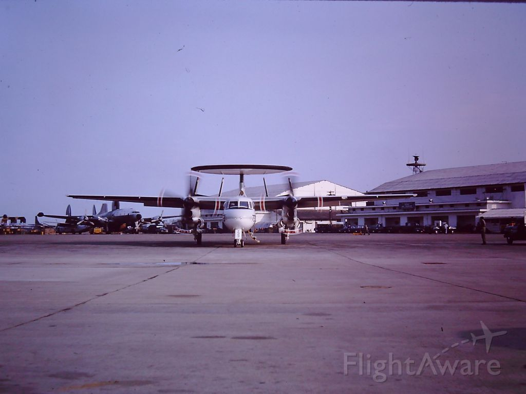 — — - TAN SON NHUT AIR BASE, SAIGON, VIETNAM 1966 – ON THE FLIGHT LINE A NAVY E-2 HAWKEYE PARKING AND A LOCKHEED CONSTELLATION PARKED, MOST LIKELY USAF, BUT AFTER 50 YEARS I JUST DON