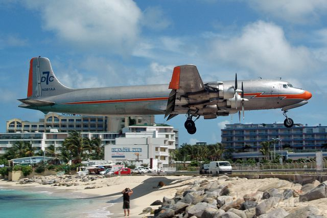 Douglas DC-7 (N381AA) - 1956 version skimming the fence with a lot of flap!