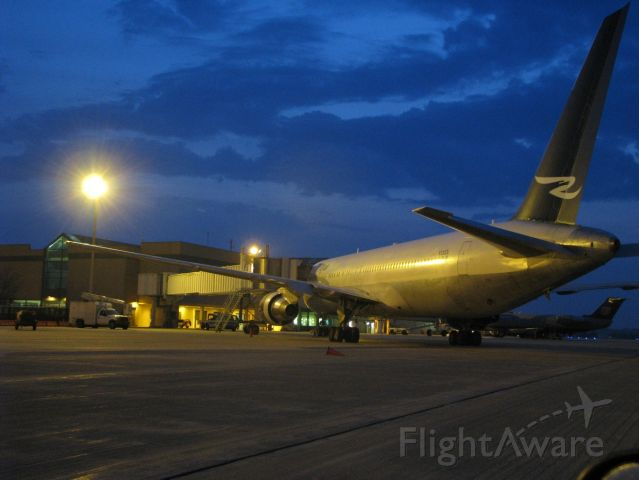 BOEING 767-300 (N120DL) - The domestic terminal ramp at dawn, with Ryan Int