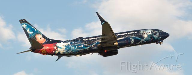 "Boeing 737-800 (C-GWSZ) - WestJet Disney ""Mickey Mouse"" plane departs IAH."