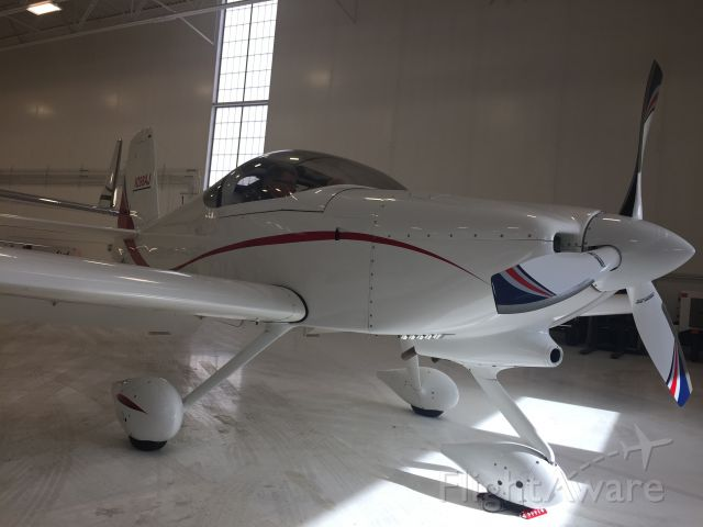 AII AVA-202 (N288AJ) - New owner Don Eller (GA Pilot) surveys his retirement gift to himself.