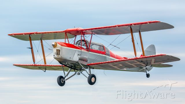OGMA Tiger Moth (C-FPHZ) - This Thruxton Jackaroo originated as a De Havilland Tiger Moth DH82A and was converted in 1958. There are not many of these still flying but here is one in flight over Guelph, Ontario, Canada.
