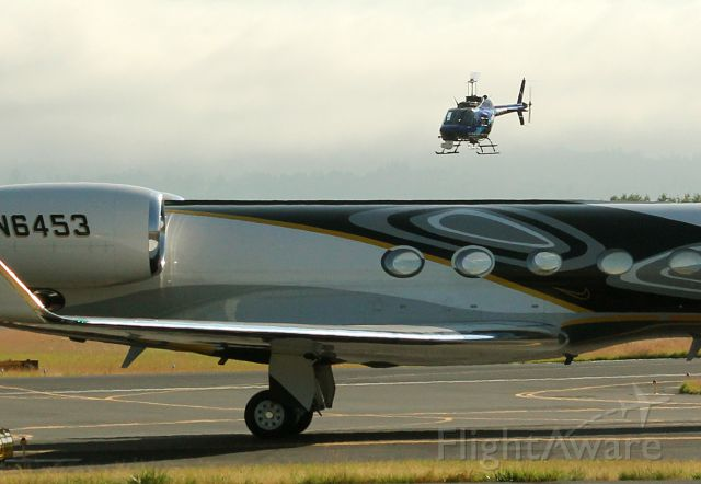 Gulfstream Aerospace Gulfstream V (N6453) - Nike Air!  1999 Gulfstream G-V Hillsboro, Oregon Rwy 31.   Note Nike swoosh under third window. 7-11-12