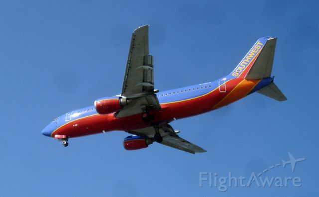 Boeing 737-500 (N510SW) - Southwest N510SW (likely) coming into Dallas Love Field on June 24th, 2009. Viewed from Bachman Lake Park. A scenic place to view traffic going into Love Field located across from runway 13R.