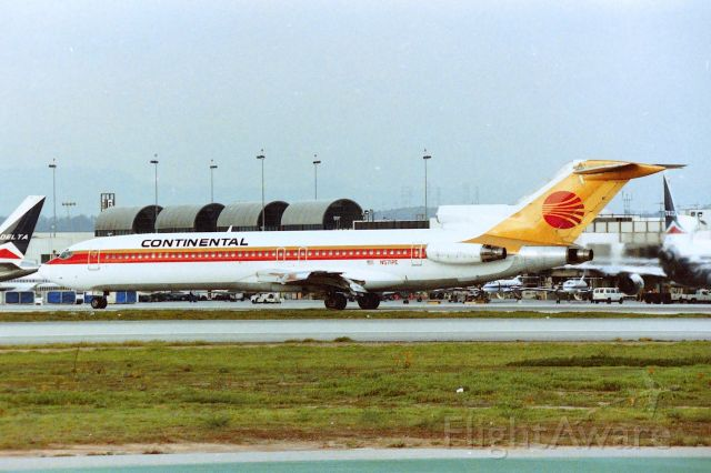 BOEING 727-200 (N571PE) - KLAX - Continental 727 rolling off 25L - photo from the old Imperial Terminal parking lot - early 1990s. I'm unsure where it was arriving from.