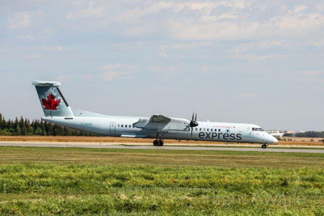 de Havilland Dash 8-400 (C-GGND) - Taxing on Runway 12/30 for Main Terminal