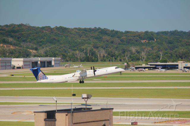 de Havilland Dash 8-400 (N204WQ) - 081415 United to Denver rotating Rwy 14R