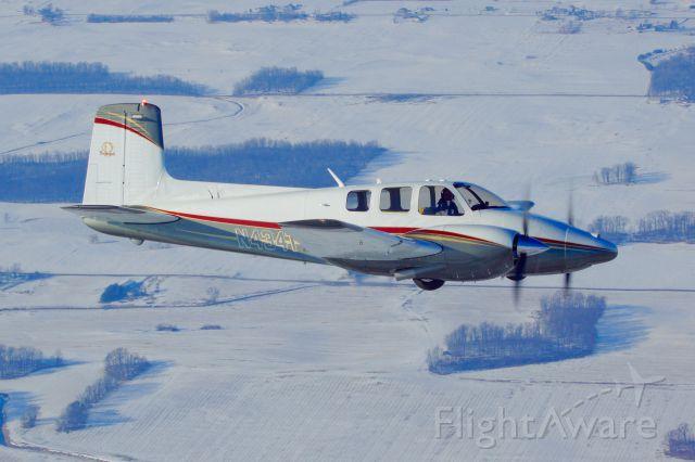 Beechcraft Twin Bonanza (N434T) - Over snowy northern Indiana.