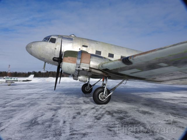 Douglas DC-3 — - DC-3 in for paint at cyqa