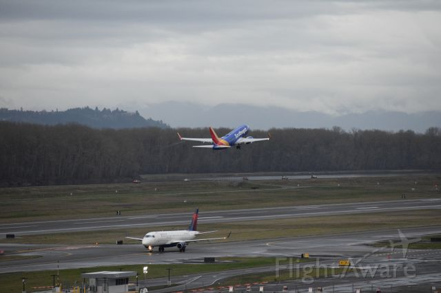 """Boeing 737-700 (N7843A) - SWA 737-7 taking off from runway 10L heading East Delta taxing to gate via """"ADAM"""" to gate heading west."""