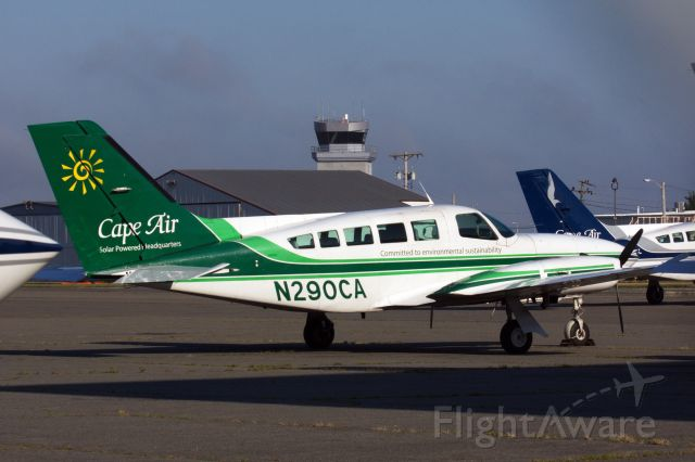 Cessna 402 (N290CA) - Cape Air's Green C402 rests in sunlight on the ramp at HYA on 7/19/20.