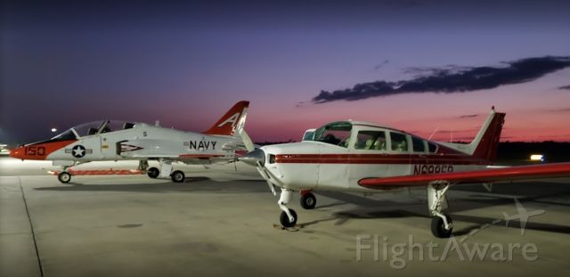 Beechcraft Sierra (N6985R) - Taking a pic next to the Navy trainers!