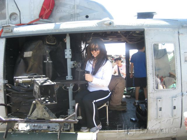 Bell UH-1V Iroquois — - Armine posing on a UH-1 at the Joint Services Open House 2011 held on Andrews Air Force Base.