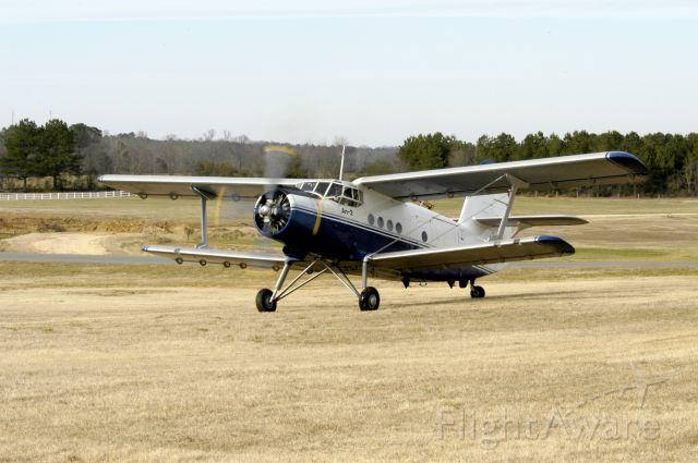 Antonov An-2 — - AN-2 on the grass a Pell City/St Clair county Airport