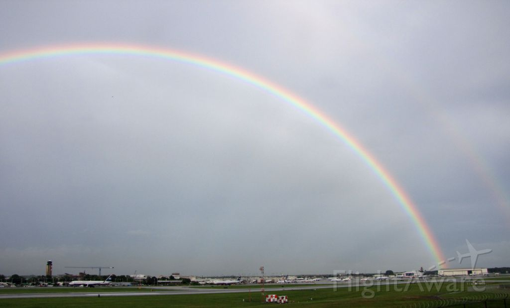 — — - June 18, double rainbow over airport after storm.