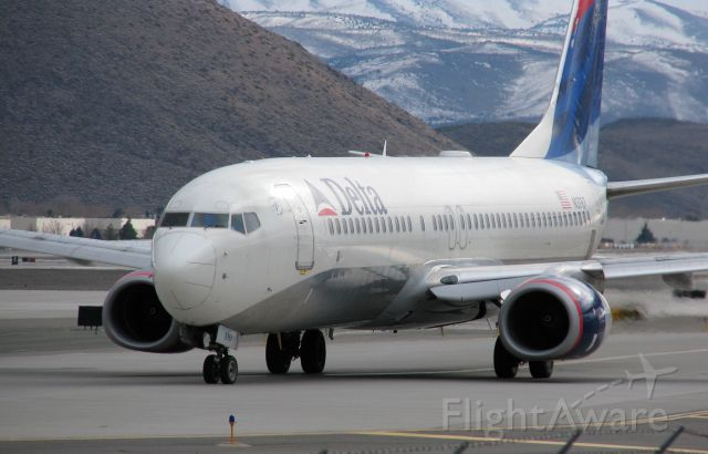 Boeing 737-700 (N3767) - Delta Airlines Flight 1142 (KRNO - KSLC) approaches on Alpha taxiway.