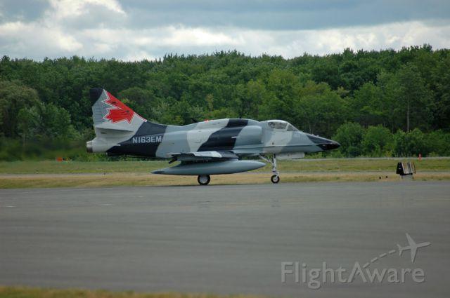 Raytheon Hawker 800 (N163EM) - McDonnell Douglas A-4N Skyhawk (Serial: 159815) preparing for takeoff from CYPQ/YPQ (June 7, 2016)